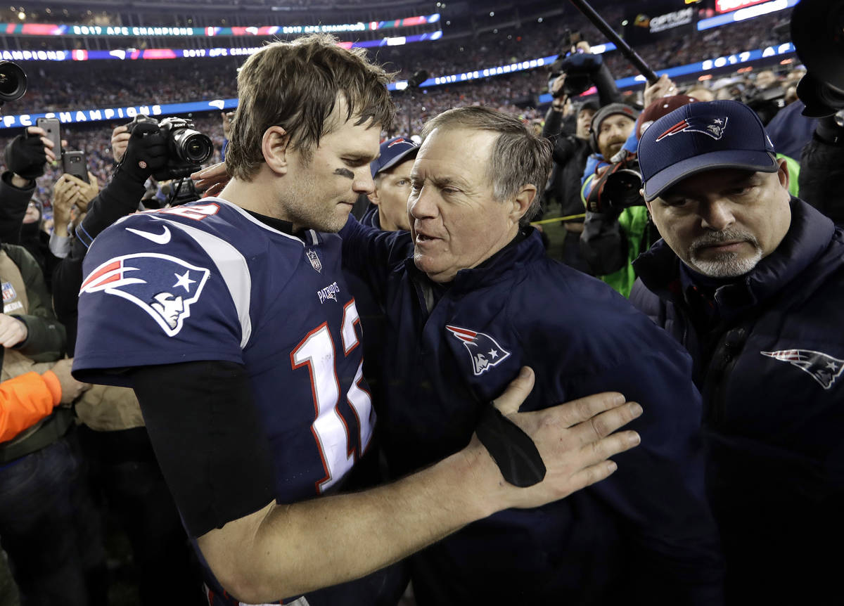 FILE - In this Jan. 21, 2018, file photo, New England Patriots quarterback Tom Brady, left, hug ...