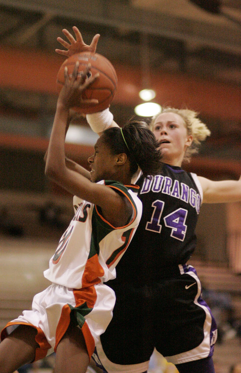 Lindy La Rocque of Durango High School, right, goes up to block Chelsea Hopkins of Mojave High ...