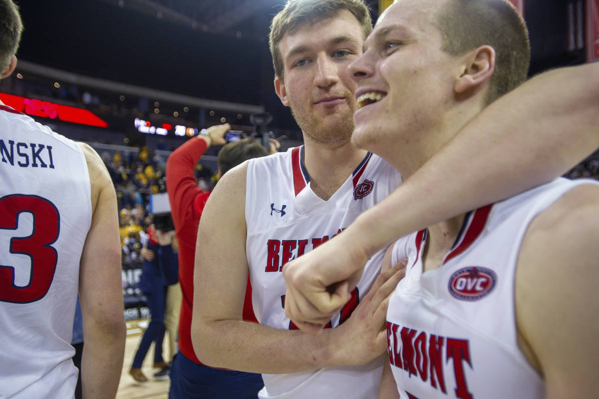 Belmont's Caleb Hollander (10) hugs Adam Kunkel (5) after the team's win over Murray State in a ...