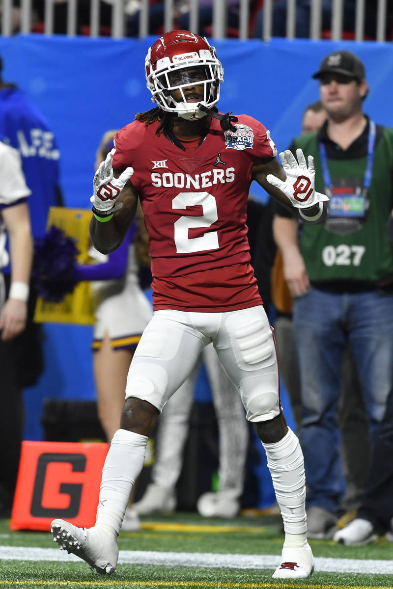 Oklahoma wide receiver CeeDee Lamb (2) celebrates a touchdown against LSU during the first half ...