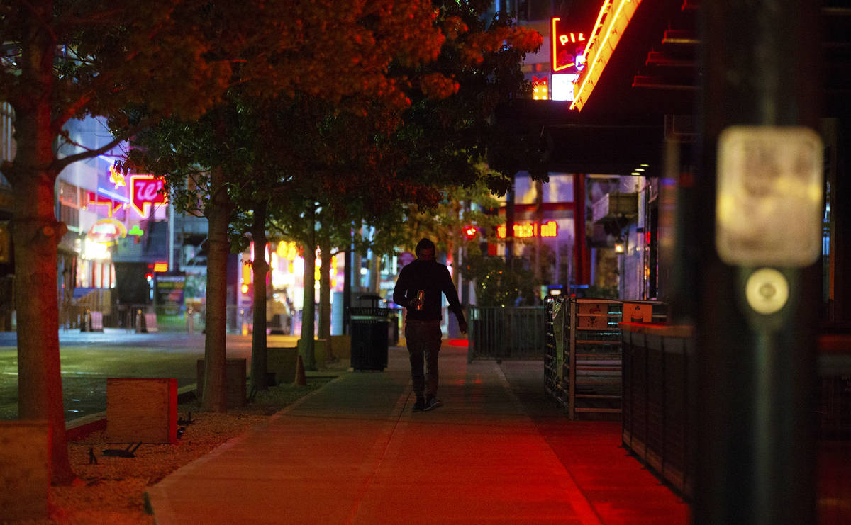 The streets of downtown Las Vegas are largely empty due to concerns related to the spread of th ...