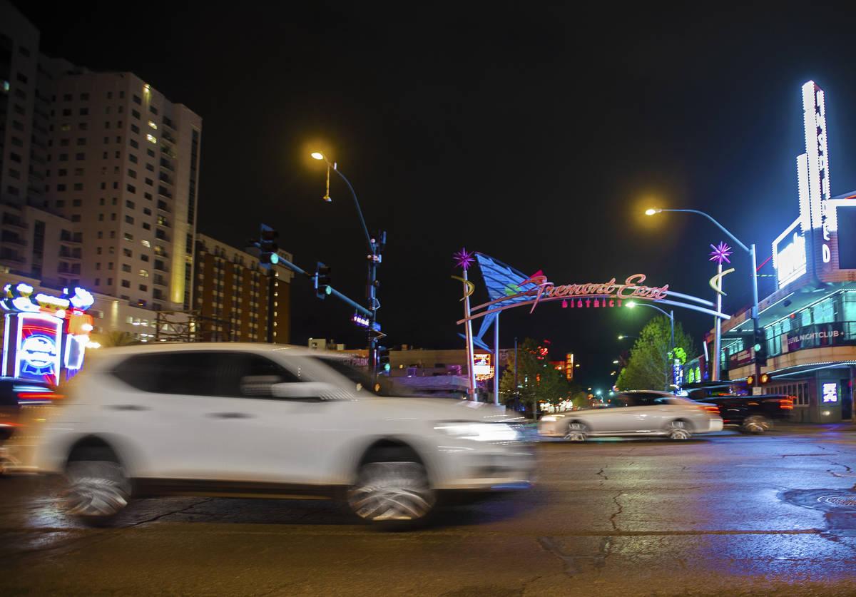 Light traffic passes through downtown Las Vegas near the Fremont Street Experience on Thursday, ...