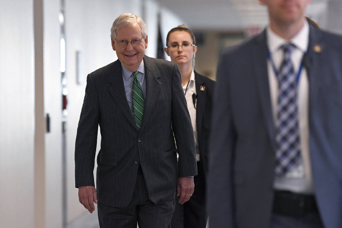 Senate Majority Leader Mitch McConnell of Ky., walk to attend a Republican policy lunch on Capi ...