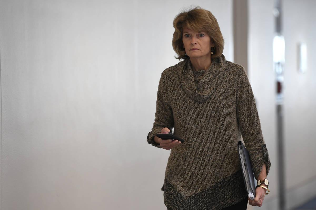 Sen. Lisa Murkowski, R-Alaska, heads into a Republican policy lunch on Capitol Hill in Washingt ...