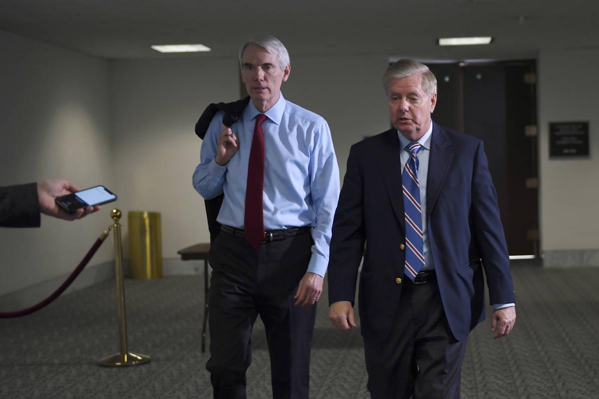 Sen. Rob Portman, R-Ohio,, left, and Sen. Lindsey Graham, R-S.C., right, leave a Republican pol ...