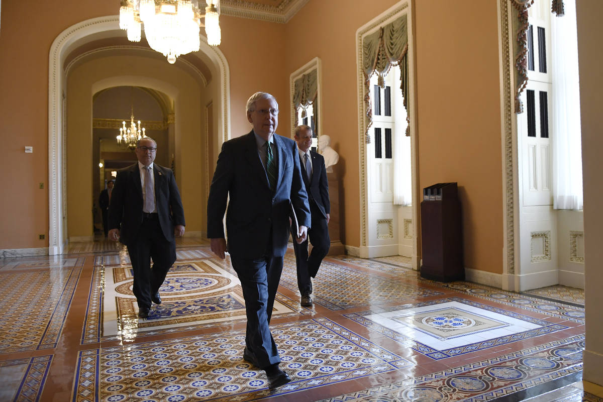 Senate Majority Leader Mitch McConnell of Ky., walks to the Senate floor on Capitol Hill in Was ...