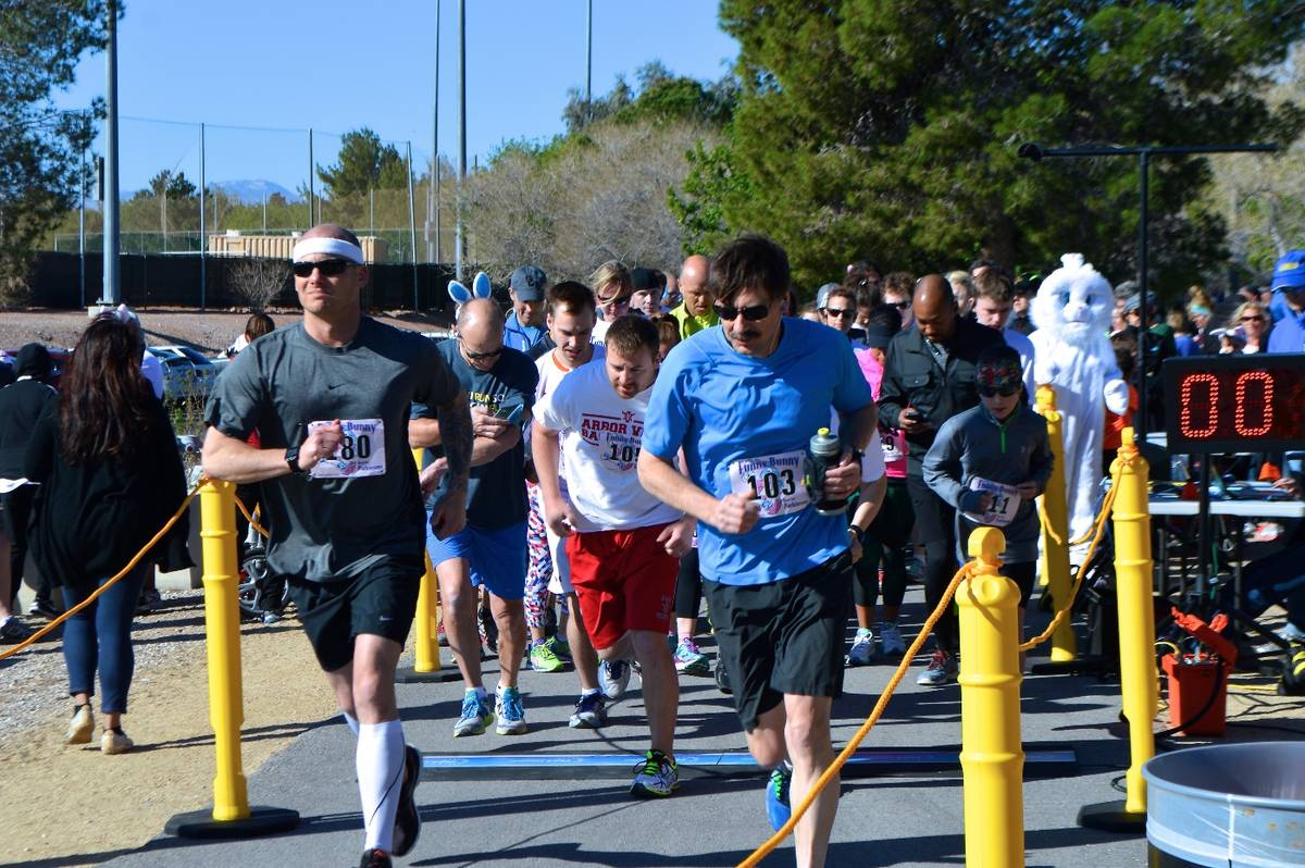 Runners participate in the annual Funny Bunny Race to benefit Friends of Parkinson's in this Ma ...