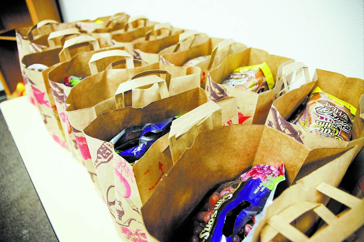 Bags prepared with one week's worth of groceries are set out for attendees of a 10-week course ...