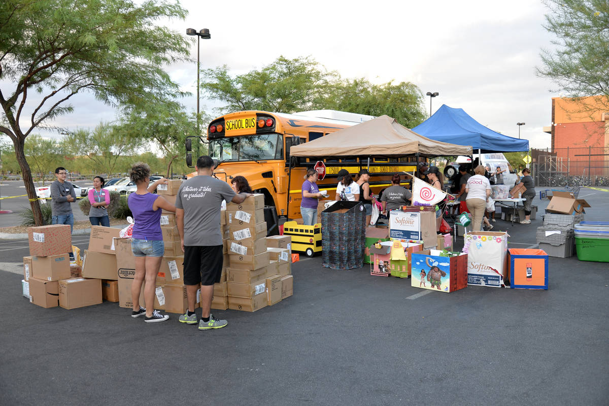 Communities in Schools of Nevada's fifth annual Fill the Bus school-supplies drive was held Aug ...