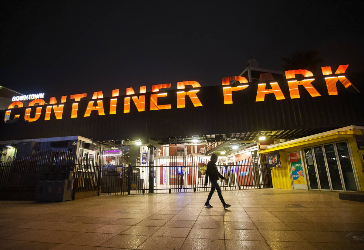 A single pedestrian passes Container Park in downtown Las Vegas, which is closed due to concern ...