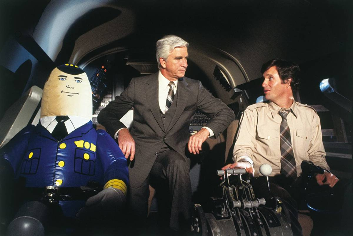 """Leslie Nielsen and Robert Hays in """"Airplane!"""" (Paramount Pictures)"""