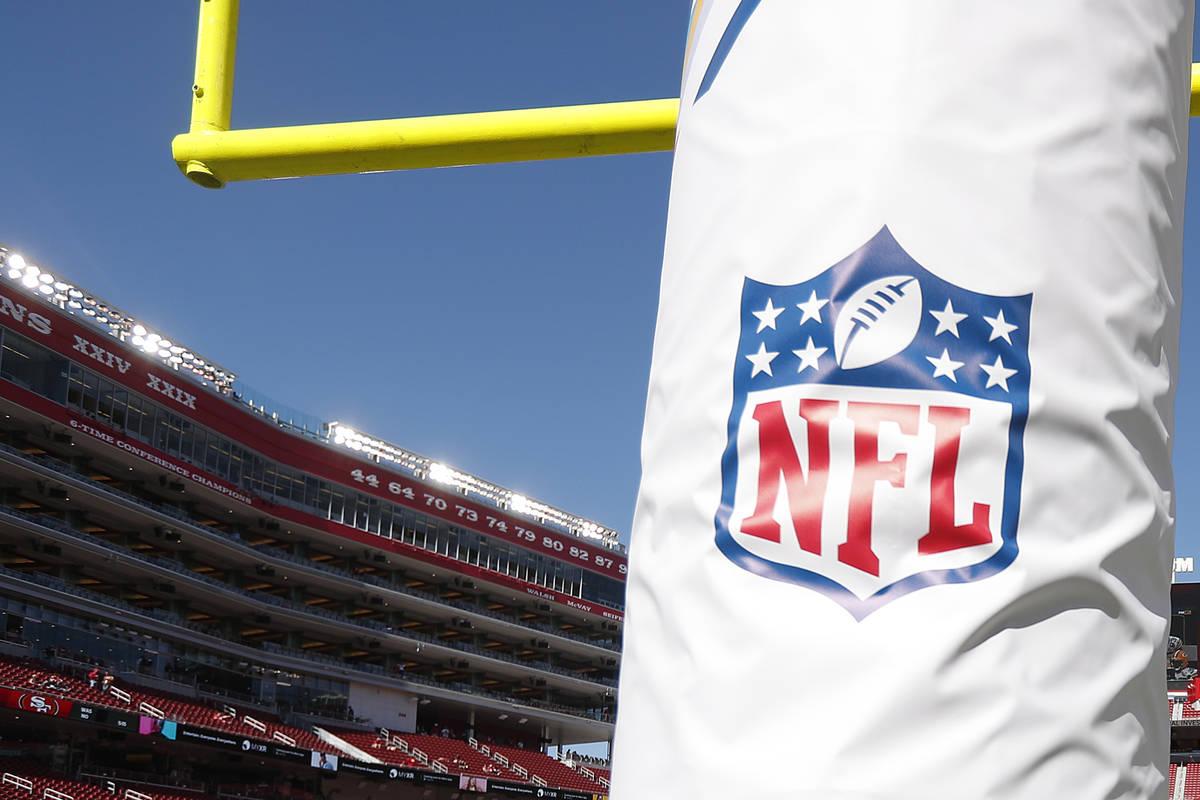 An NFL logo on a goal post pad. (AP Photo/Tony Avelar)