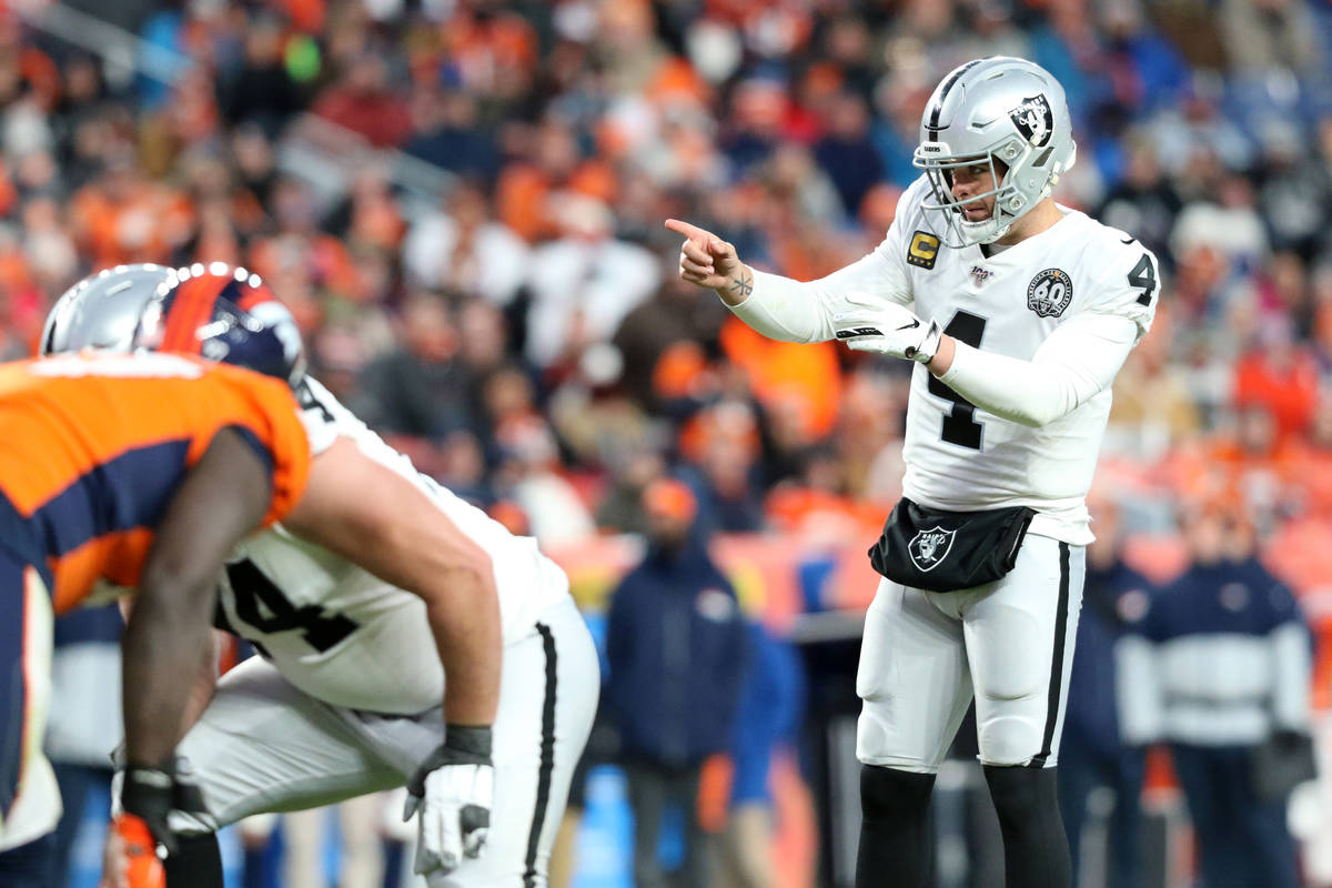 Oakland Raiders quarterback Derek Carr (4) gestures during the second half of an NFL game again ...