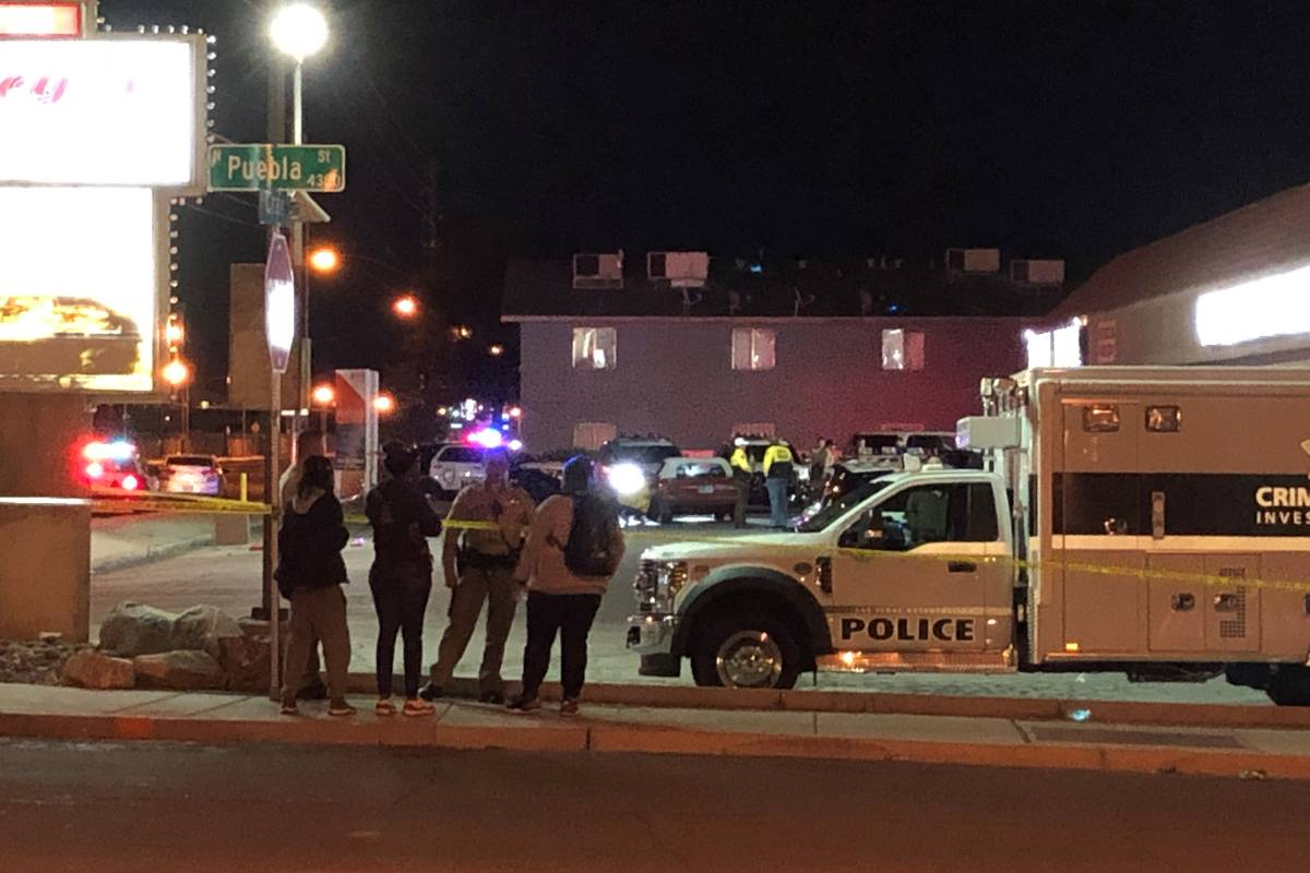 Police investigate a shooting in the 4700 block of East Craig Road in Las Vegas on Friday, Marc ...