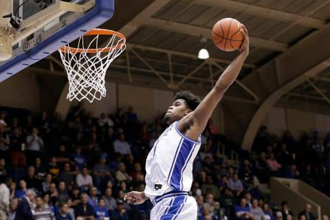 FILE - In this Oct. 30, 2019, file photo, Duke center Vernon Carey Jr. (1) drives to the basket ...