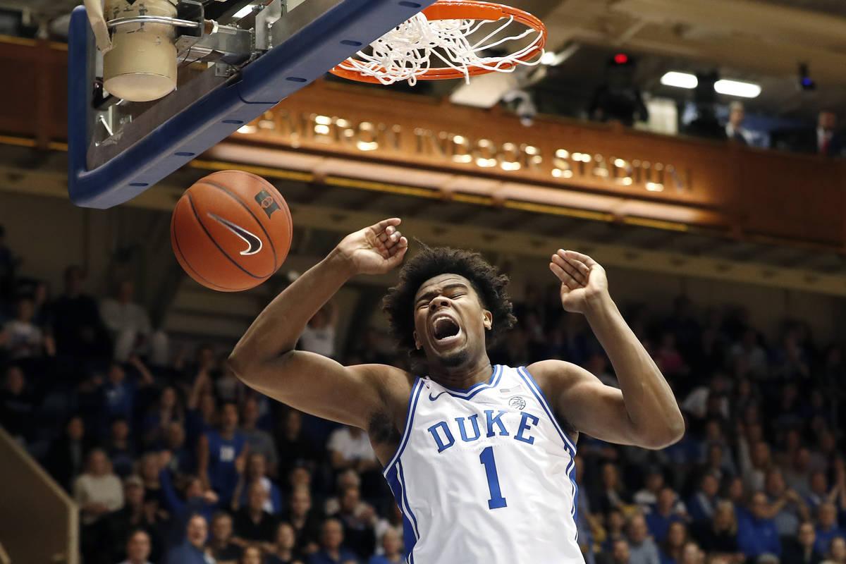 FILE - In this Dec. 31, 2019, file photo, Duke center Vernon Carey Jr. dunks against Boston Col ...