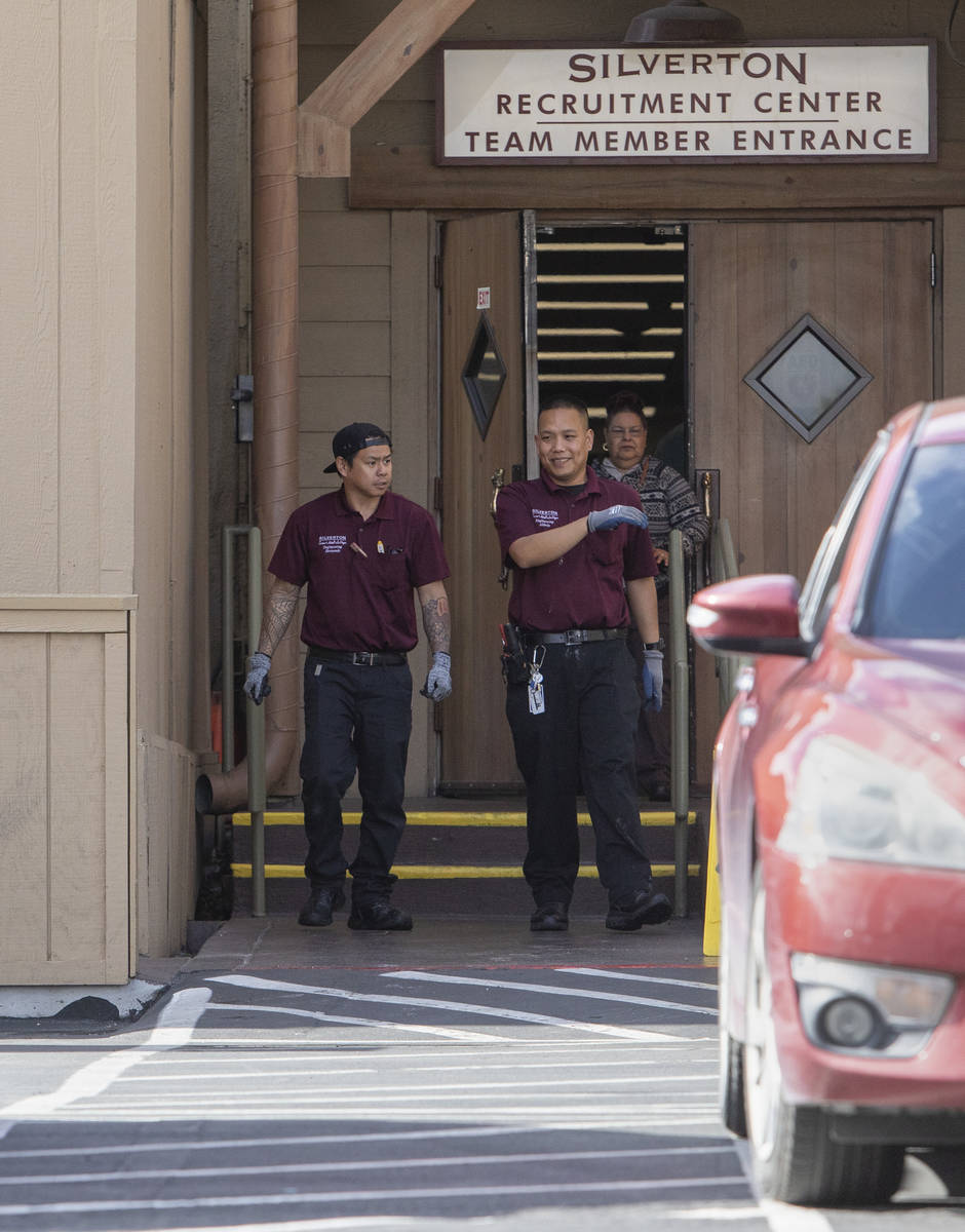 Employees exit Silverton Casino into the team member parking lot on Friday, March 20, 2020, in ...