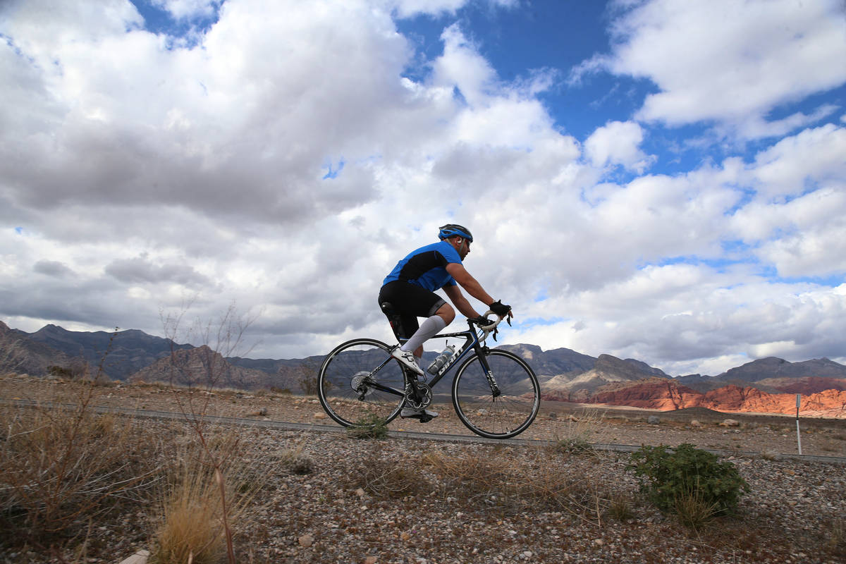 A cyclists makes his way north on Route 159 at Red Rock Canyon in Las Vegas, Saturday, March 21 ...