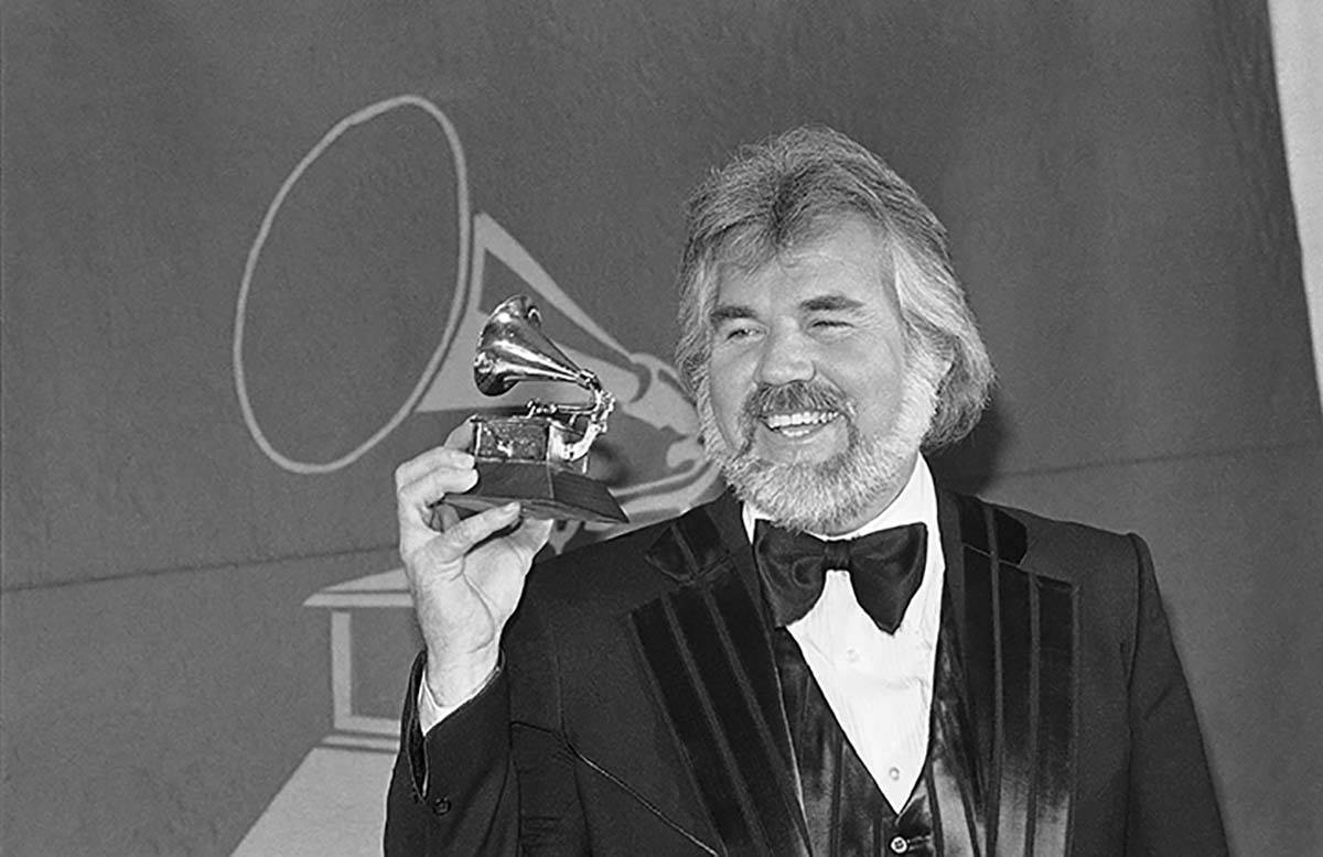 In this Feb. 28, 1980 file photo, Kenny Rogers holds a Grammy Award he received during presenta ...