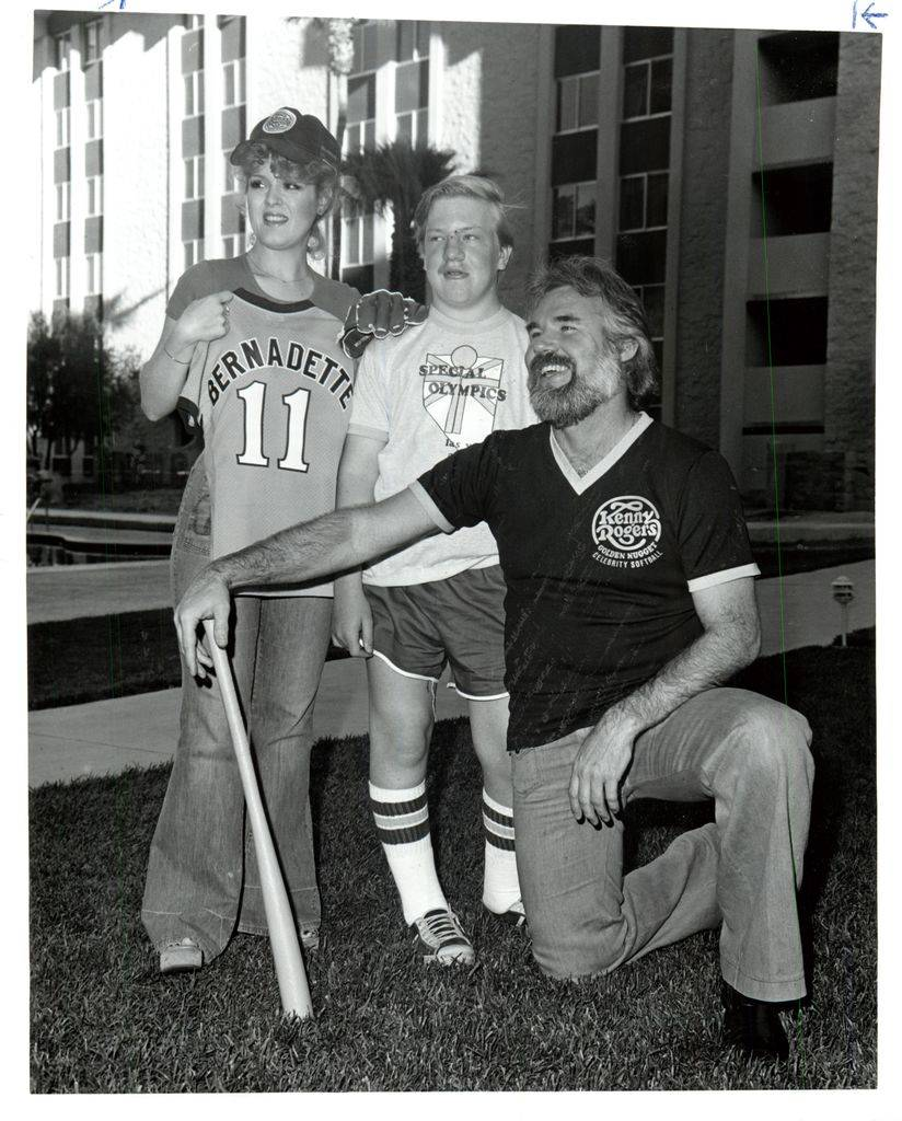 Kenny Rogers and Bernadette Peters with a participant of Special Olympics in an undated file ph ...