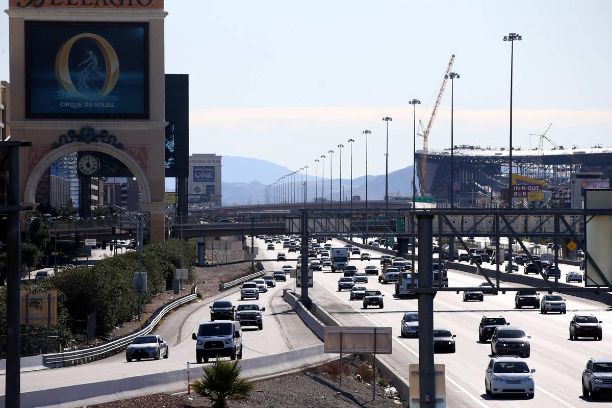Vehicles travel on Interstate 15 adjacent to the Strip in Las Vegas Monday, Dec. 16, 2019. (K.M ...
