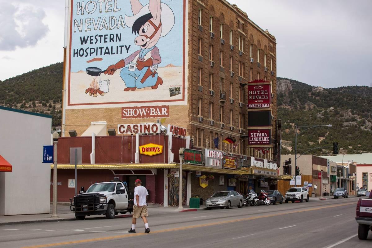 A man walks across Aultman Street, the main road through Ely, near Hotel Nevada In July 2018. ( ...