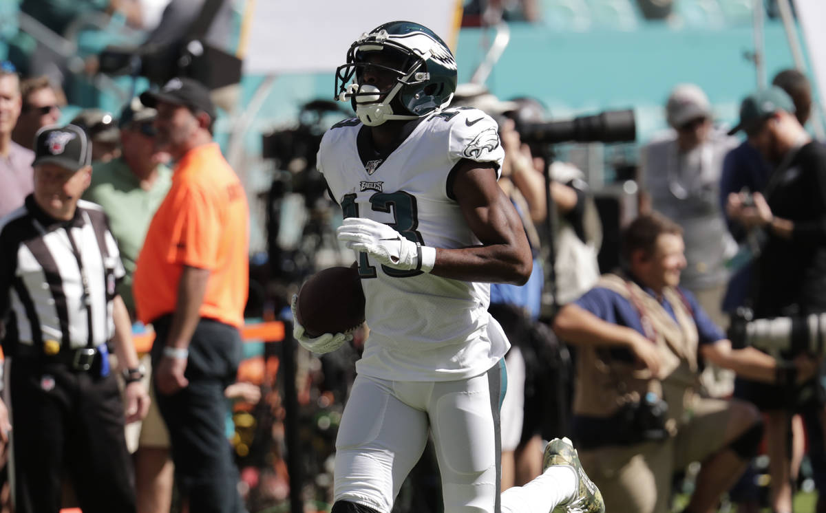 Philadelphia Eagles wide receiver Nelson Agholor (13) warms up, before an NFL football game aga ...
