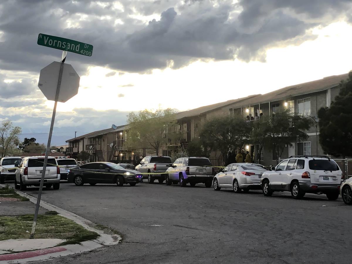 Police serve a warrant at a home on Corsaire Avenue near Vornsand Drive in Las Vegas on Saturda ...
