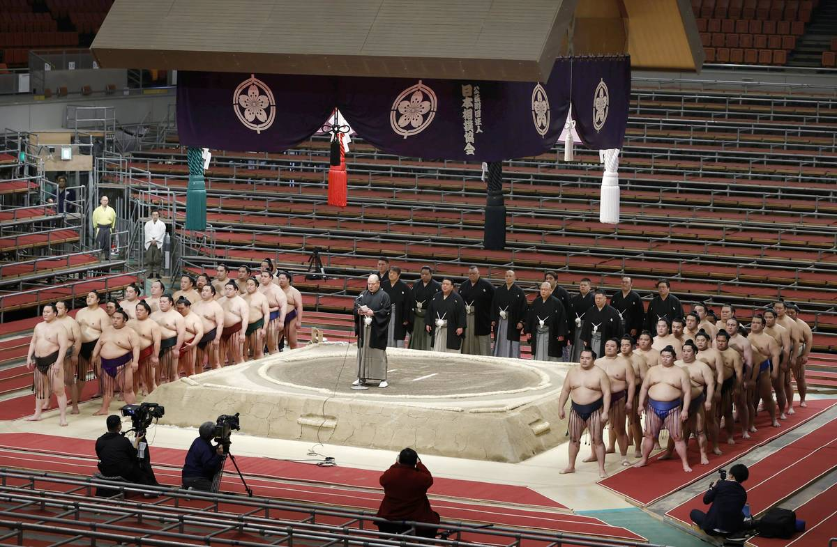 Japan Sumo Association Chairman Hakkaku (on the raised ring) delivers a speech in closing the S ...