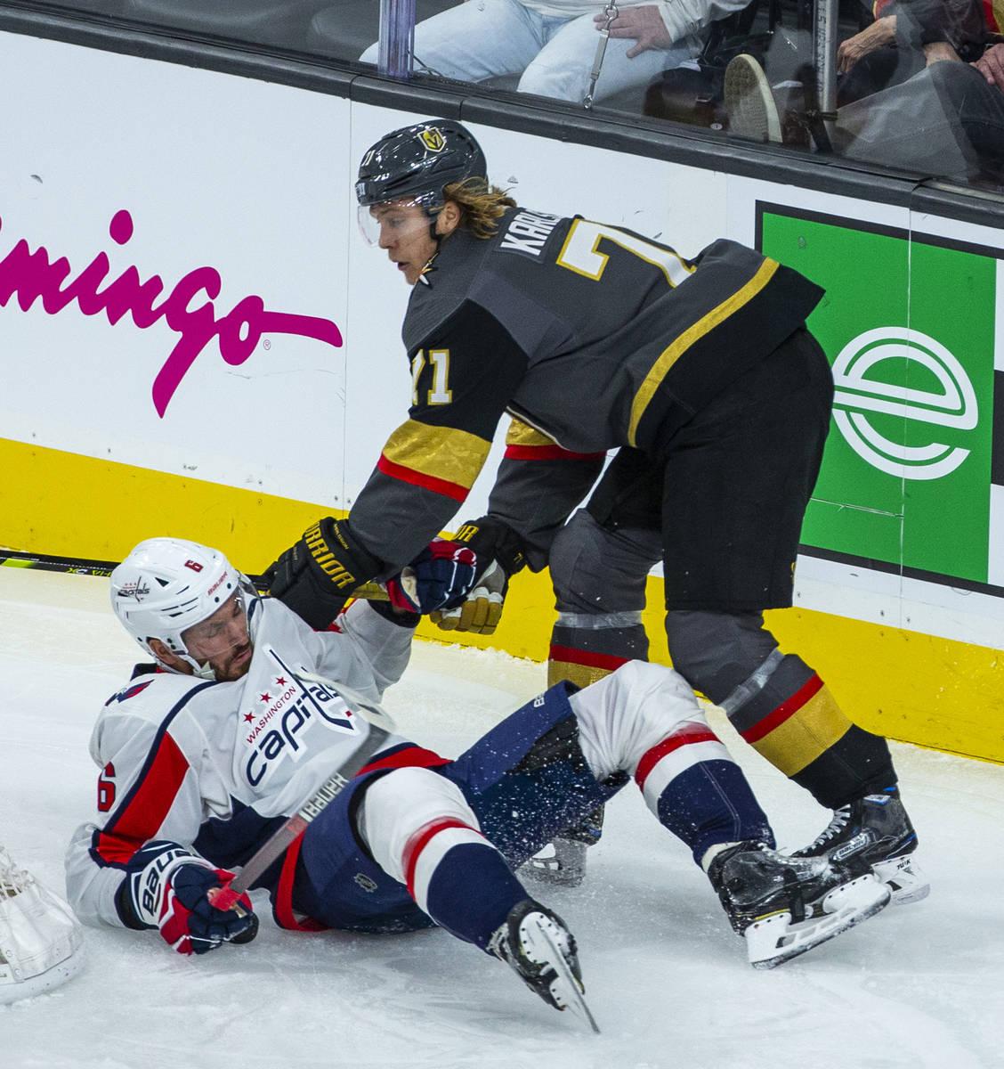 Vegas Golden Knights center William Karlsson (71, right) knocks Washington Capitals defenseman ...