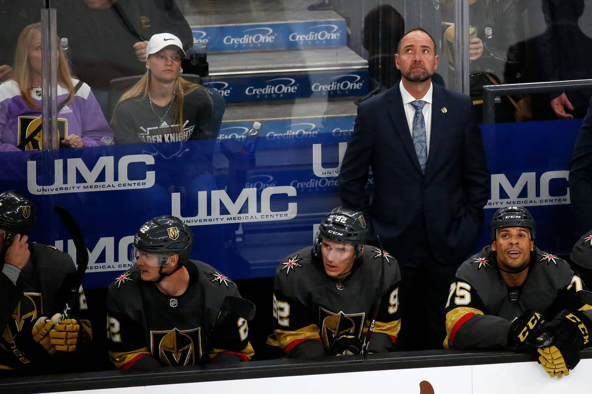 Vegas Golden Knights head coach Pete DeBoer looks up at the display board in the second period ...
