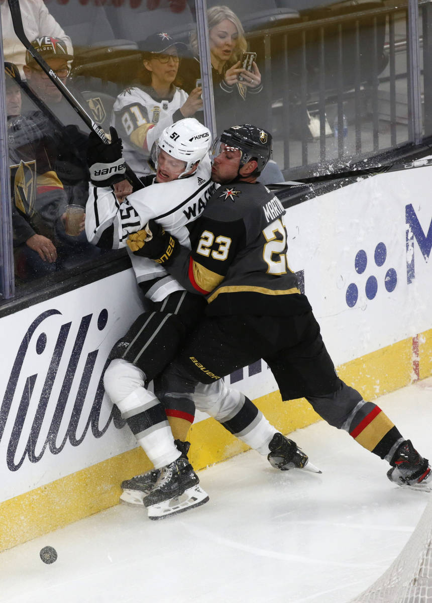 Vegas Golden Knights defenseman Alec Martinez (23) and Los Angeles Kings left wing Austin Wagne ...