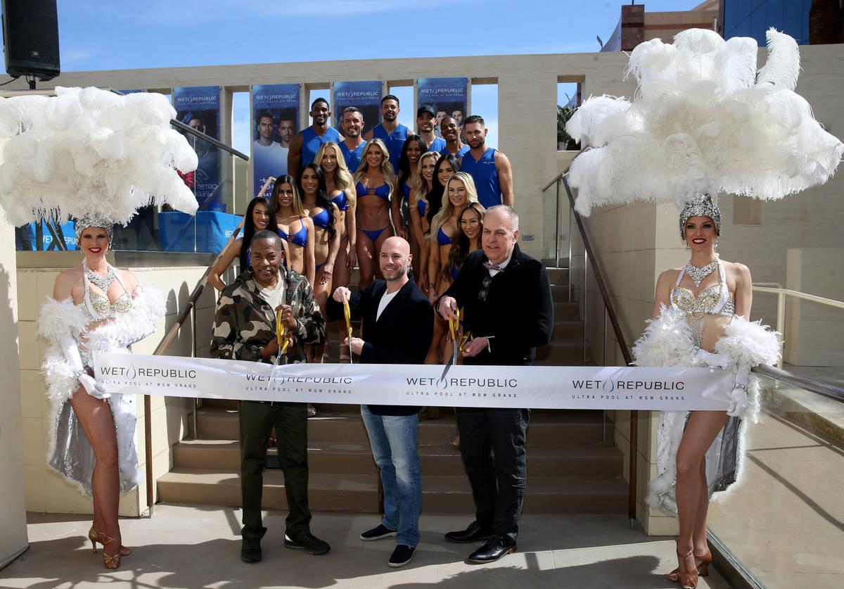 Derek Silberstein, executive vice president of nightlife for Hakkasan Group, center, cuts the r ...