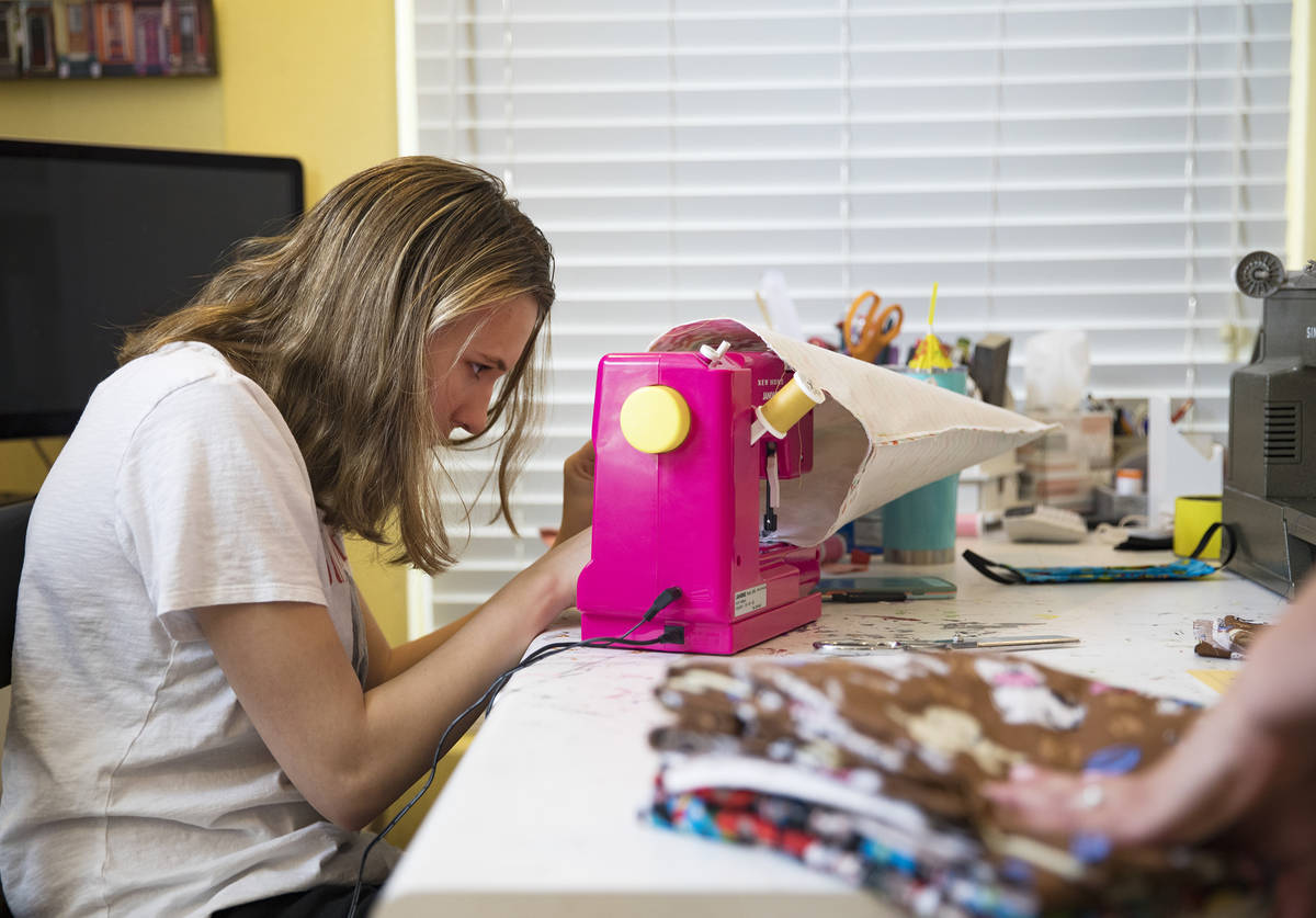 Grace Gustafson, 13, works on a mask at her home in Las Vegas, Sunday, March 22, 2020. She has ...