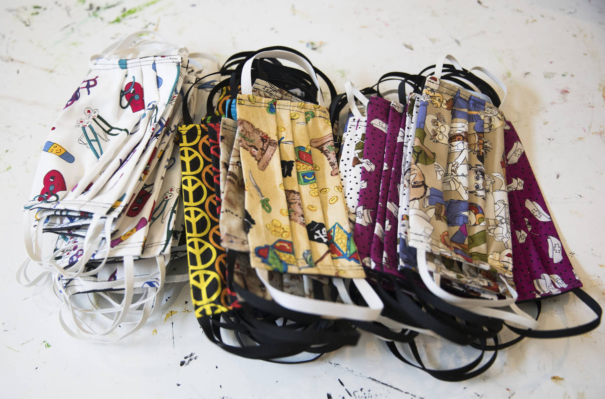 A pile of masks at the home of Anissa Gustafson in Las Vegas, Sunday, March 22, 2020. She has b ...