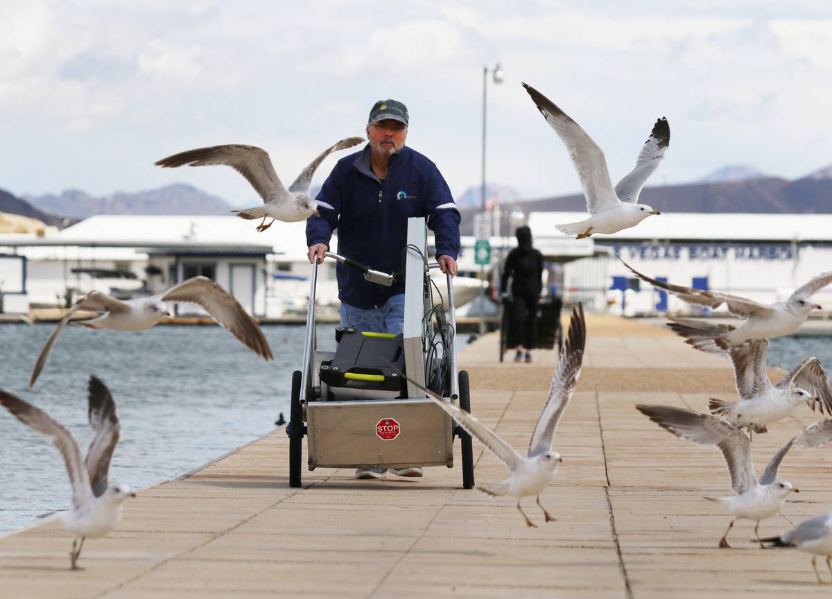 Miguel Matos pushes his belongings that were retrieved from his boat at Lake Mead National Recr ...