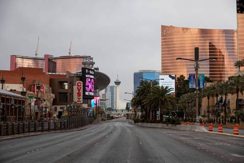Dark clouds bring light rain over the Las Vegas Strip in Las Vegas on Monday, March 23, 2020. ( ...