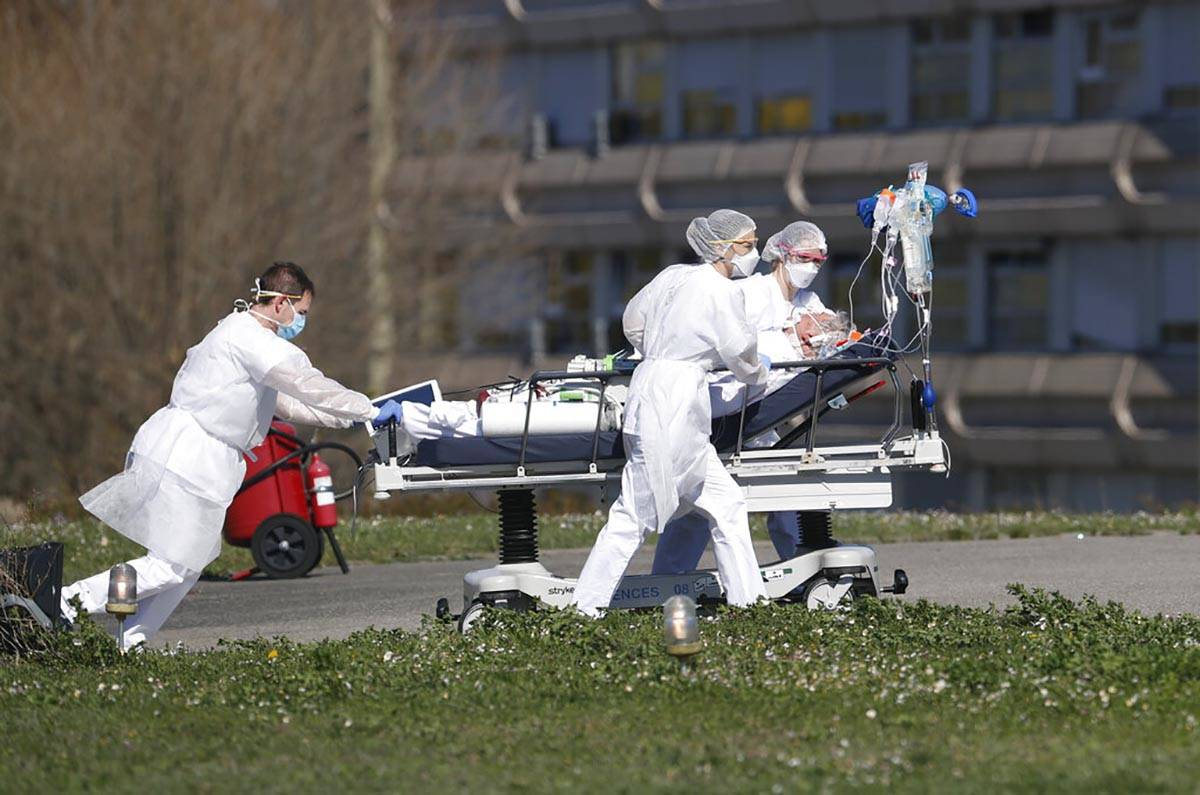 A victim of the Covid-19 virus is evacuated from the Mulhouse civil hospital, eastern France, M ...