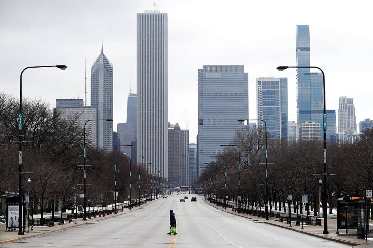 An elderly lady walks across the usually busy Columbus Drive that splits Chicago's Grant Park i ...