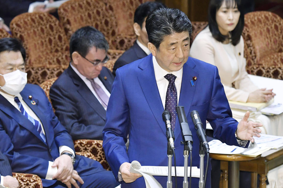 Japan's Prime Minister Shinzo Abe speaks at a parliamentary session in Tokyo Monday, Mar ...