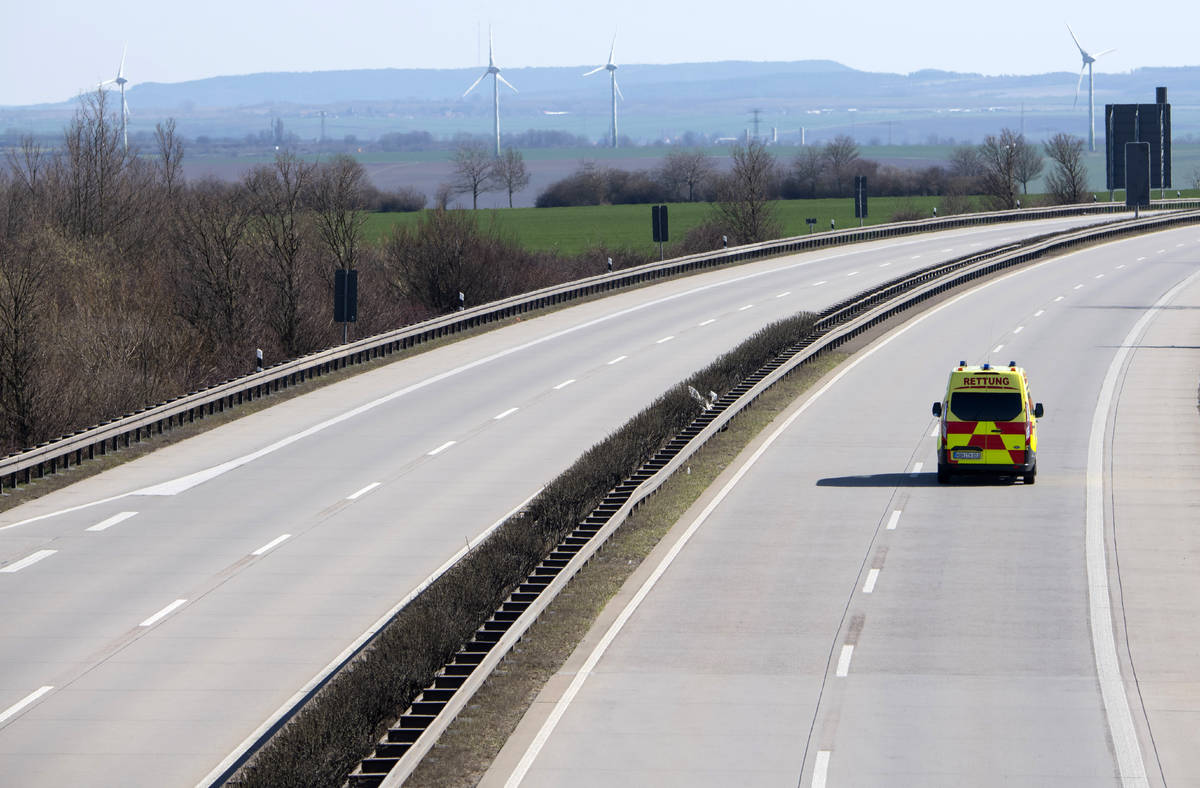 An emergency and rescue car drives on the deserted A4 highway near Erfurt, Germany, Monday, Mar ...