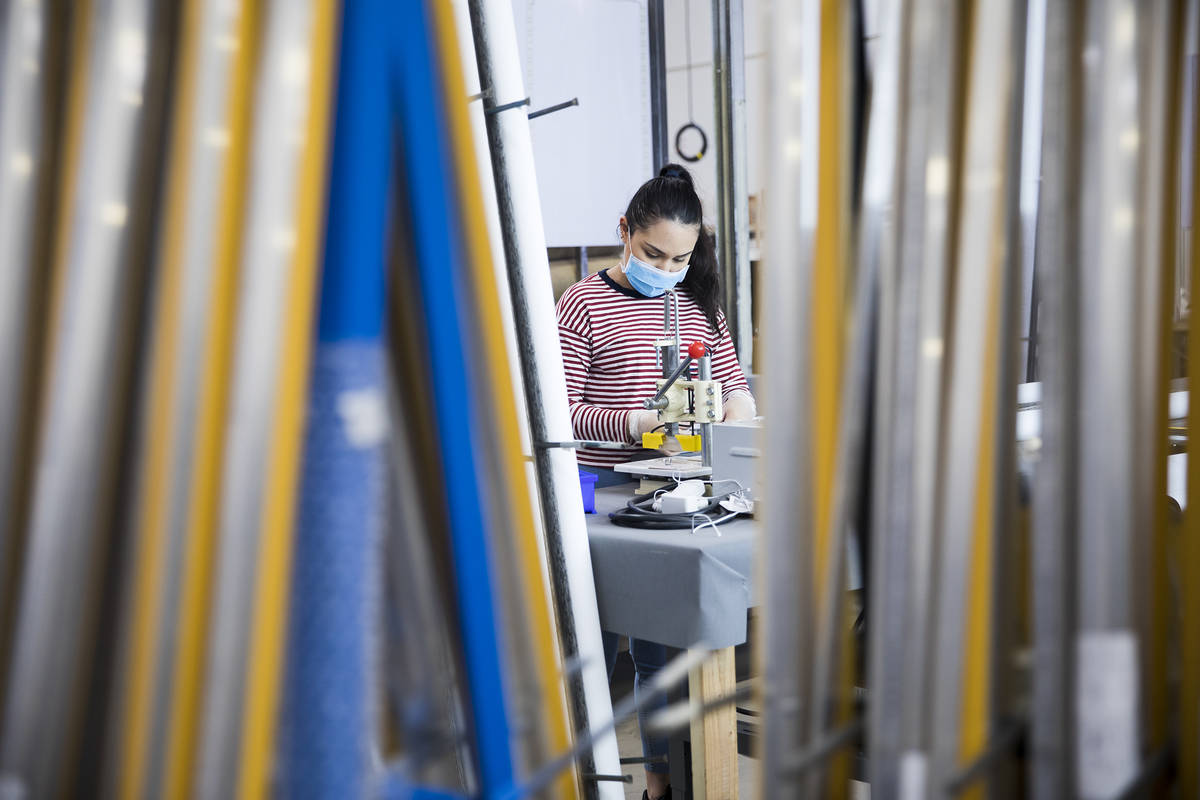 Annie Duenez seams the fabric of a roller shade at Polar Shades in Las Vegas, Monday, March 23, ...