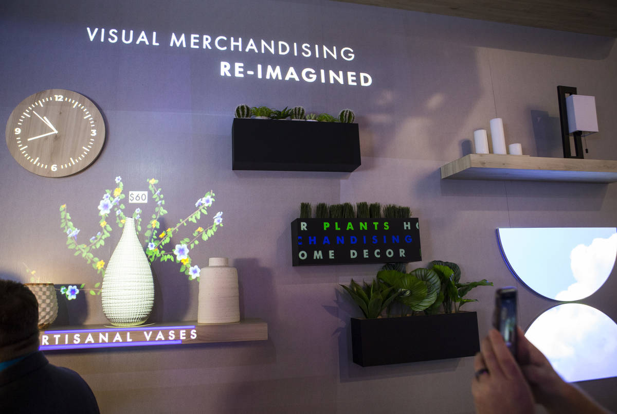 Projected displays are shown at the Epson booth at the Digital Signage Expo at the Las Vegas Co ...