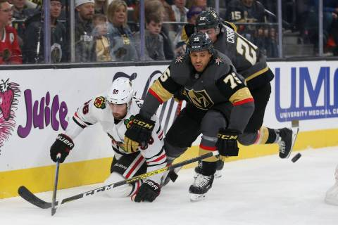 Vegas Golden Knights right wing Ryan Reaves (75) and Chicago Blackhawks defenseman Erik Gustafs ...