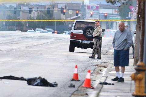 Las Vegas Metropolitan Police Department officers investigating after two male pedestrians were ...