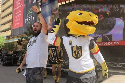 "Wayne ""Big D"" Danielson and Chance the gila monster celebrate the Vegas Golden Knights 2-1 vict ..."