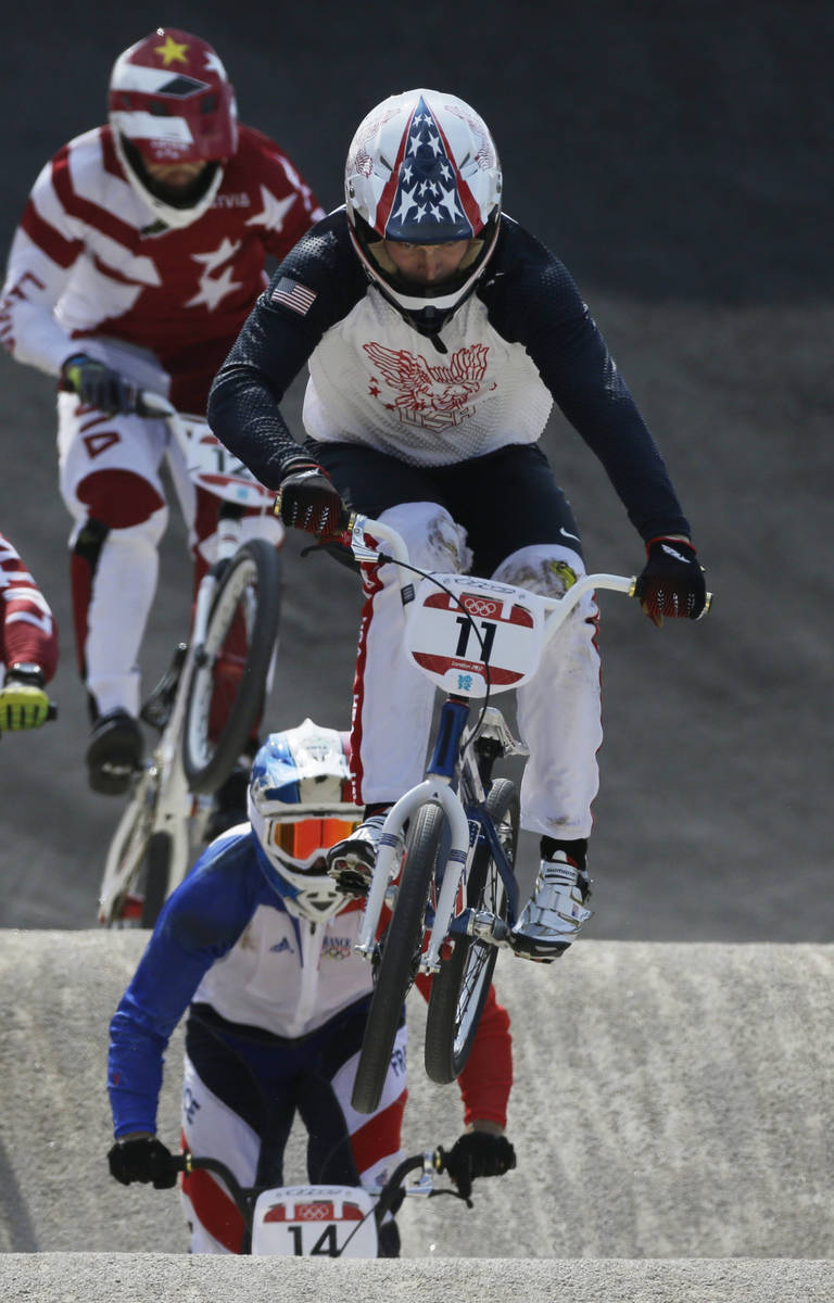 United States' Connor Fields (11) competes in a BMX cycling men's semifinal run during the 201 ...