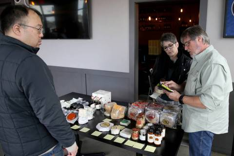 Michael Stamm, owner of MGP Specialty Food, right, and cheese consultant Carolene Belasco sell ...