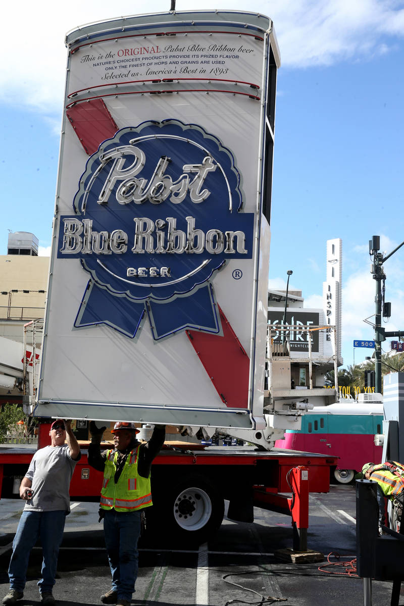 Yesco workers remove the Pabst Blue Ribbon neon sign at Fremont Street and Las Vegas Boulevard ...