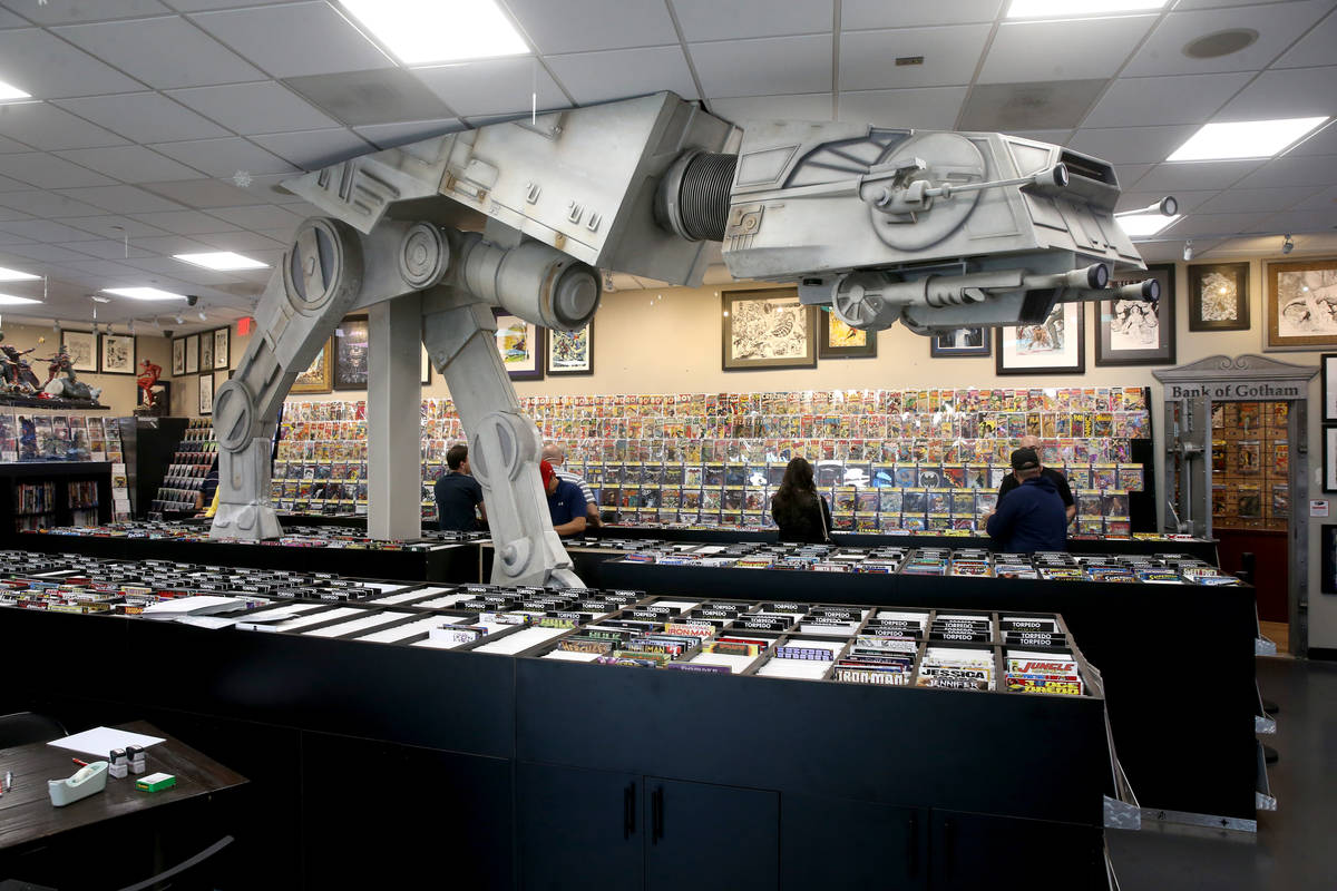 People browse for comics before a visit by DJ Steve Aoki for a signing for his new comic book s ...